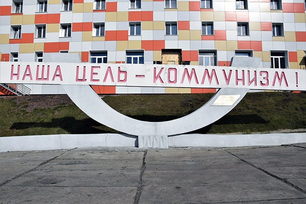 """The Soviet-era monument in Barentsburg, Norway. The inscribed text reads """"Our goal – Communism!"""""""
